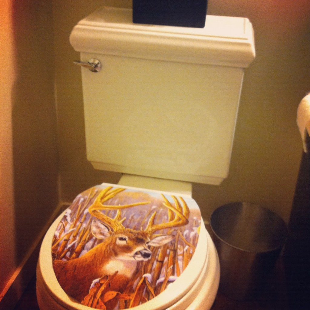 a deer head on my toilet via @jennyonthespot |jennyonthespot.com