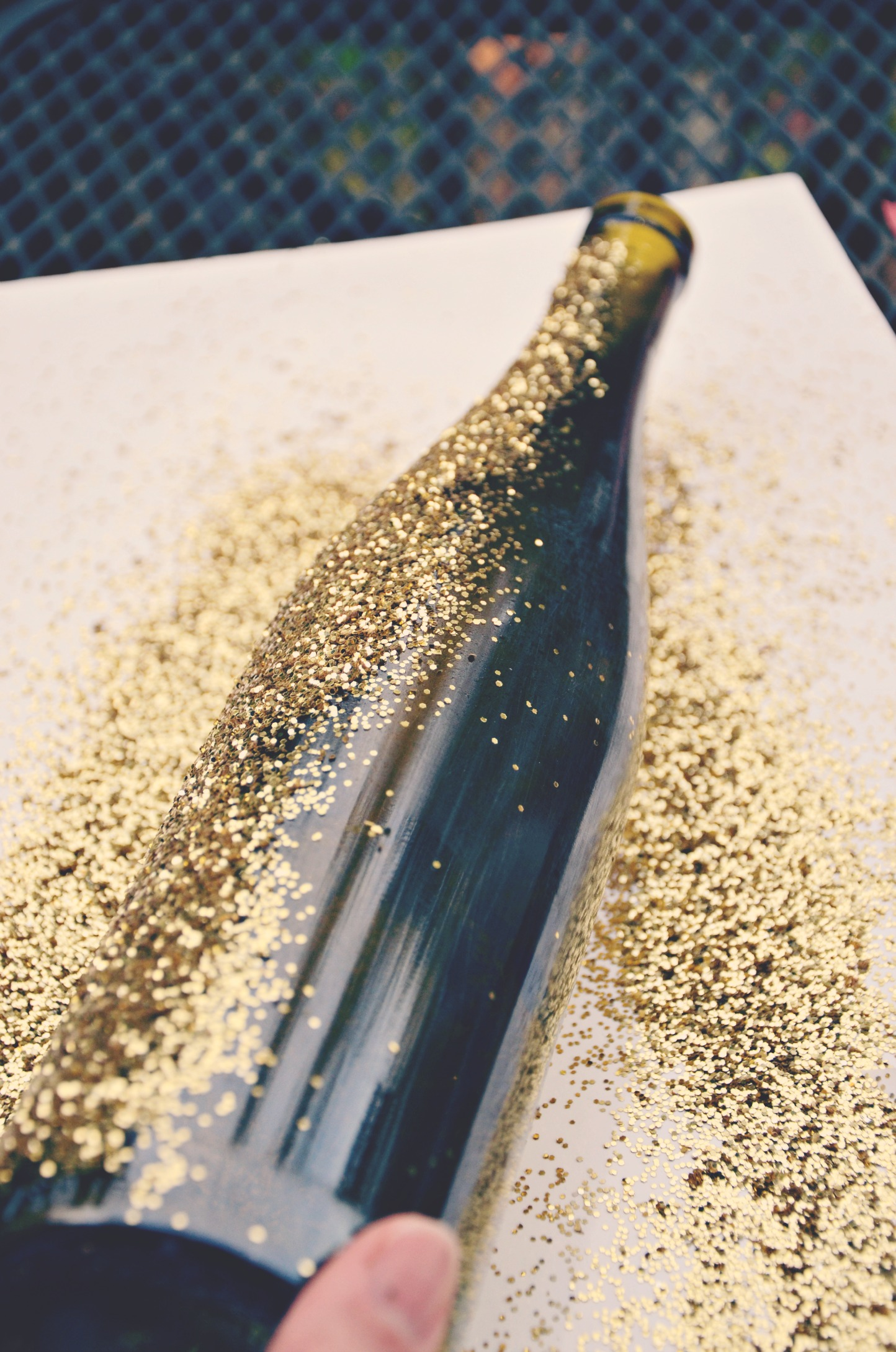 Tutorial for diy glittered wine bottles jenny on the spot for How to make wine bottle crafts