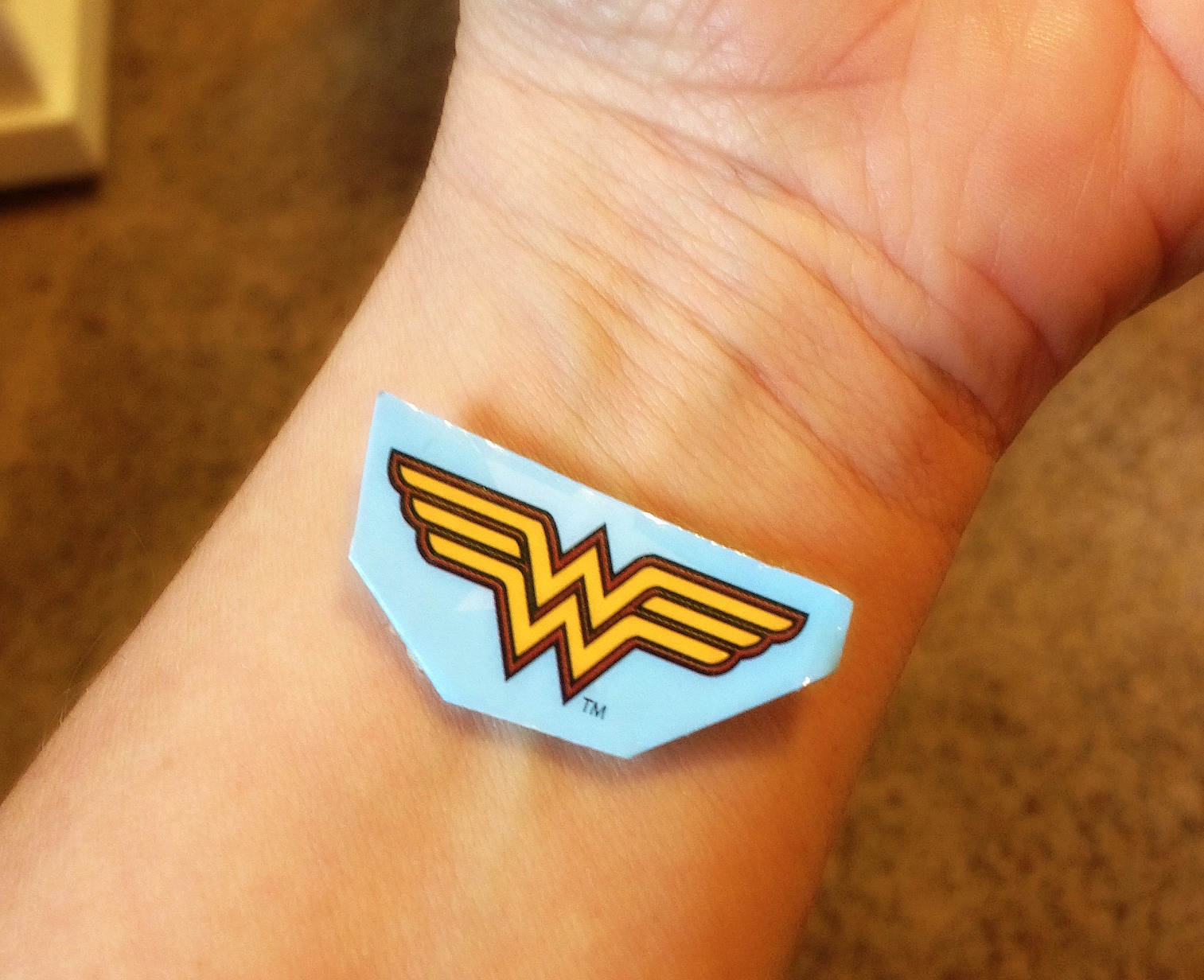 Wonder woman symbol tattoo